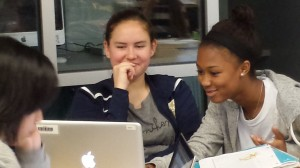 Ella Burge and Kaylan Ware look over their interview notes to identify what's quote worthy.