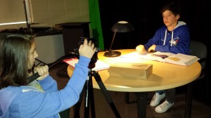 Lia Bodine and Elijah Maris shoot a scene in the studio.