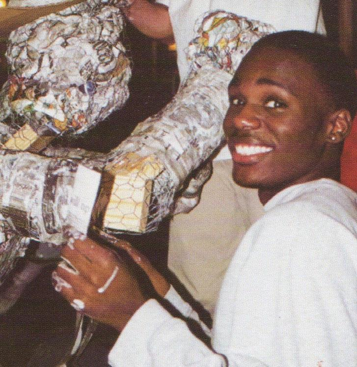 A senior from the class of 1998 works on a float. The floats are built using chicken wire and paper-mache.