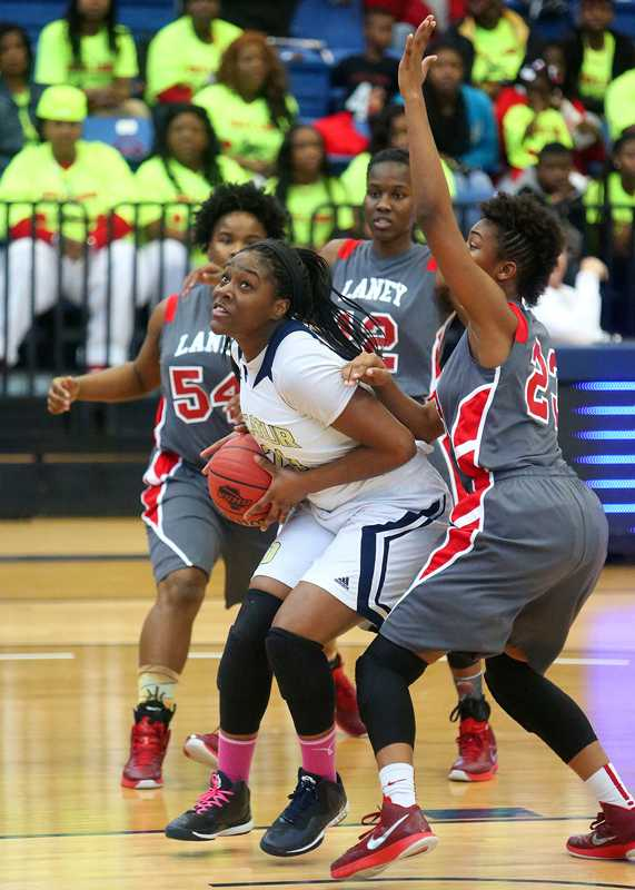 Janay Williams is defended by three players from Laney High school in the semi finals,