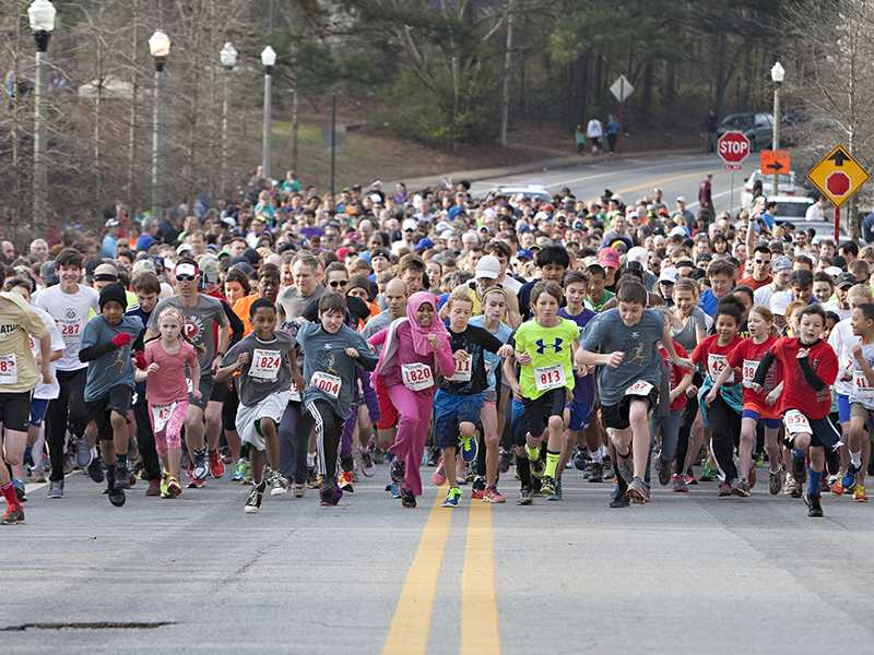 2014s 5k race started behind the stadium. The winners of the race are divided into age and gender, but Junior Ryter (gold shirt on left) won first place overall.