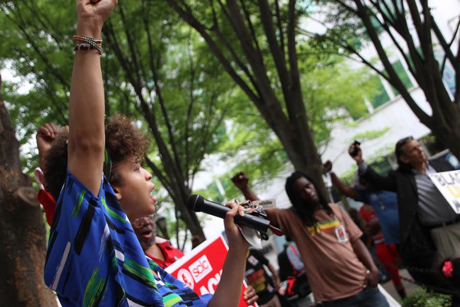 "Activist Nat Soul rallies at #ShutdownA14, an April 14 protest in Atlanta.  ""Being together in this kind of environment empowers [people] to make a change,"" she said."
