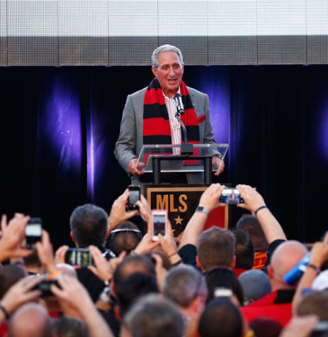 After Sports Illustrated leaked Atlanta United FC's name and logo two weeks early, owner Arthur Blank gathered the press and over 4,000 fans on Jul. 7, 2015, at the SOHO lounge to publically release the team's look. The team's red, black and gold kits include the red and black scarf pictured on Blank.