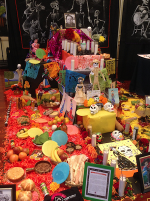 Families honor loved ones through the use of marigold flowers, foods, and colorful decorations set up on alters.
