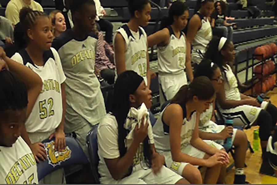 Decatur Girls Basketball team comes up with a strategy to try to come back and win the game in the second quarter time out.