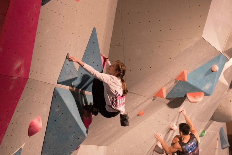 Audrey Miller climbs at the Youth Bouldering Nationals in 2015 in Madison, Wisconsin.