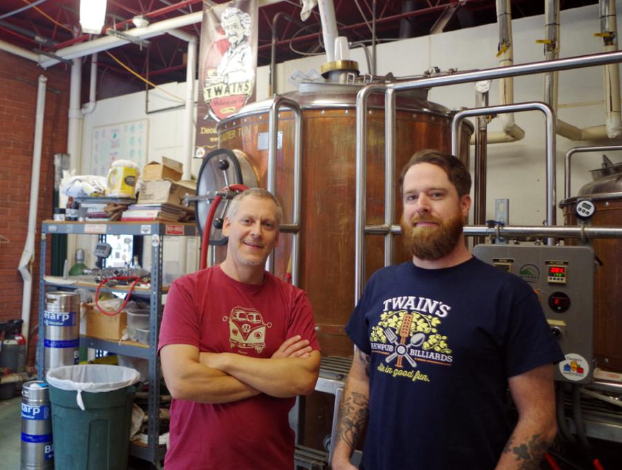 Standing left is Ethan Wurtzel, a founder of Twains, on his right is Ben Horgan, general manager, in front of the Twains brewery. The brewery was installed in 2006 and is a staple at Twains. Wurtzel and Horgan plan to integrate their speciality product into Comet Pub and Lanes.
