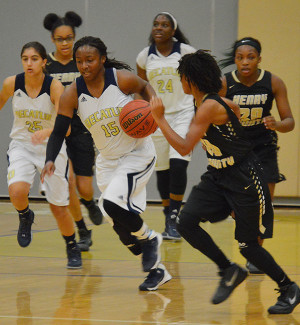 Kierra, number 15, and one of two team captains, steals the ball and leads the team down the court to make a basket.