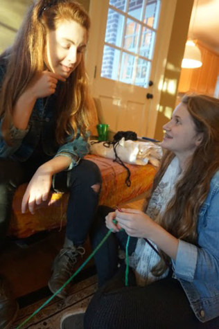 Club member Ayston Scully (right) teaches newbie Skylar Rhame (left) how to knit at the first knitting club of the year.