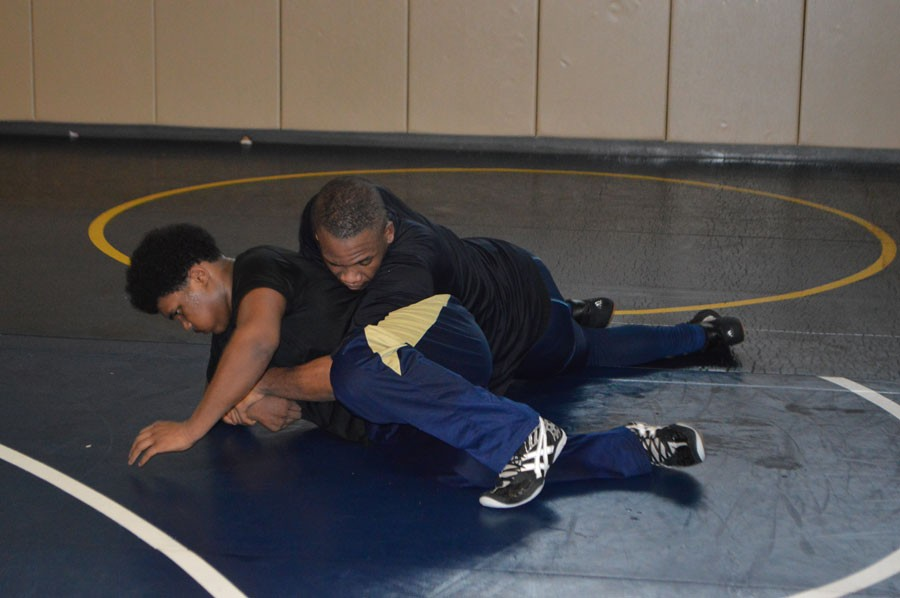 Alan Fergurson trying to escape from getting pinned by Noah Boyer.