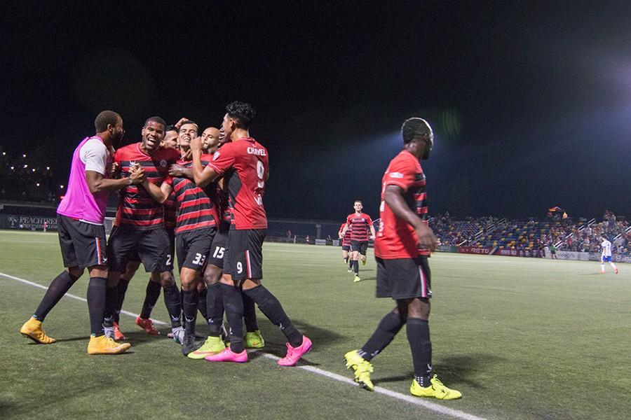 The Atlanta Silverbacks celebrate a late goal by Junior Burgos to win the match. The Silverbacks defeated FC Edmonton by a score of 1-0 on Aug. 29, 2015.