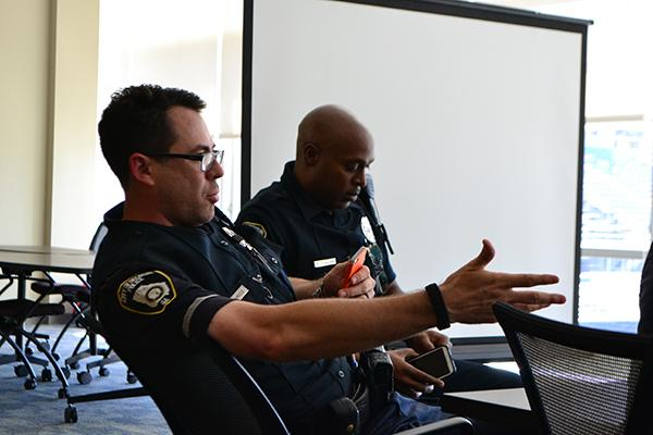 Officer Damico (left) and Officer Phillips (right) attended the forum to answer students' questions about law enforcement.