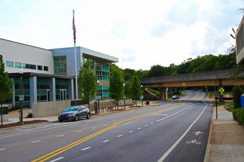The recently renovated Decatur police station stands out in contrast to the overpass.