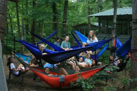 "Brush and her fellow CITs gather in ""eno city."" This is a picture of everyone in what was called ""eno city"". ""Almost everyone brings an eno with them to camp and we all set them up in the middle of the CIT unit as a place that we can all hang out and do our work,"" she said."