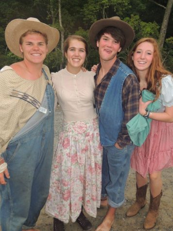 "Stormey Barton, senior Olive McKay, Michael Toole, and Leah Hayes are dressed up fror tableau night at Carolina Point. Tableau night is part of ""the best night of camp"" which includes surprises and activities for campers."