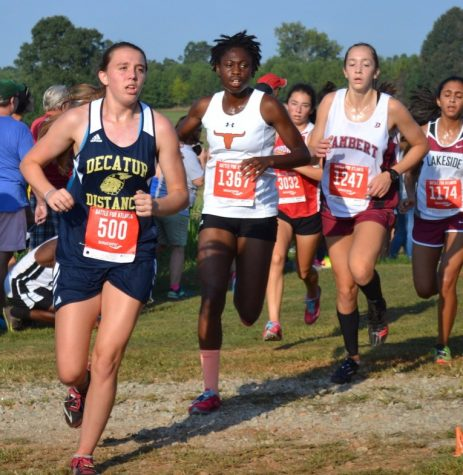 Sophomore Maggie Carlton runs in a meet against other cross country teams.
