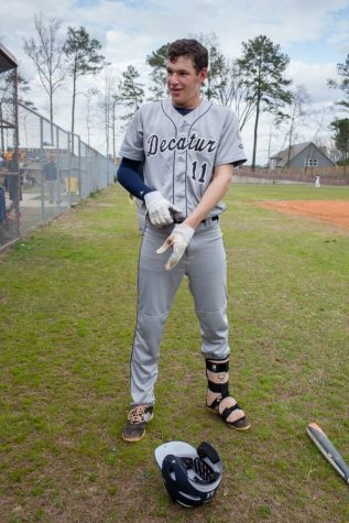Conway winding down after an at bat for school ball. In the 2016 season, he started every game at third base for the bulldogs.