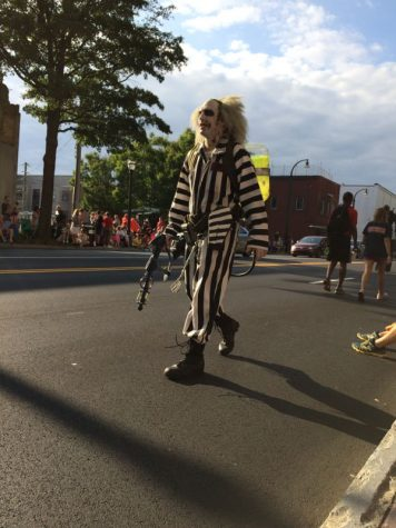 Man dressed as a Ghostbuster Beetlejuice walks down Peachtree Street