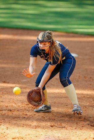 Senior first baseman Olivia Brozek fields a grounder against Dunwoody on Aug. 22. She leads the team with 61 RBIs.