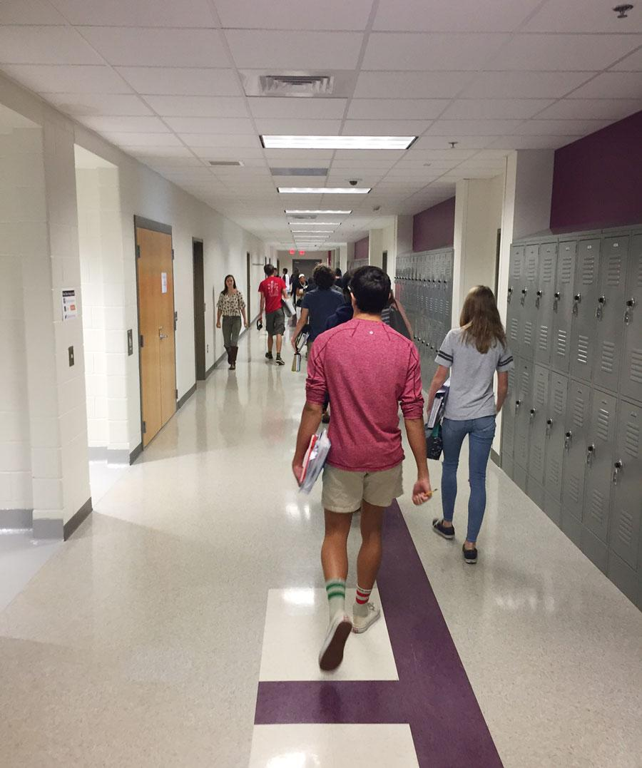 During a class change, students navigate the new building to find their new classrooms.