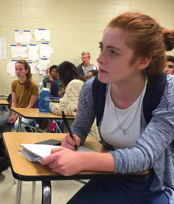 """Junior Skylar Rhame, who attended the first meeting, wanted to take notes on the information presented about stock markets. """"Happy Herold, myself and Molly Weston are on a team together, and we really want to win,"""" Rhame said, """"so we definitely wanted to pay attention."""""""