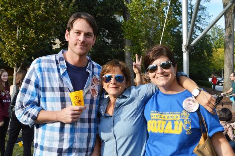 Diane Capriola, owner of Little Shop of Stories (center), poses with German teacher Brent Eickhoff (left) and IB Coordinator Cheryl Nahmias (right) at Kidtoberfest.