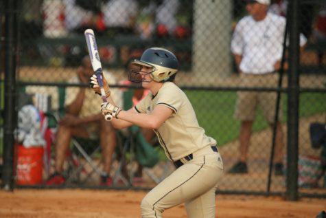 Junior Audrey Miller bunts a ball during a tournament.
