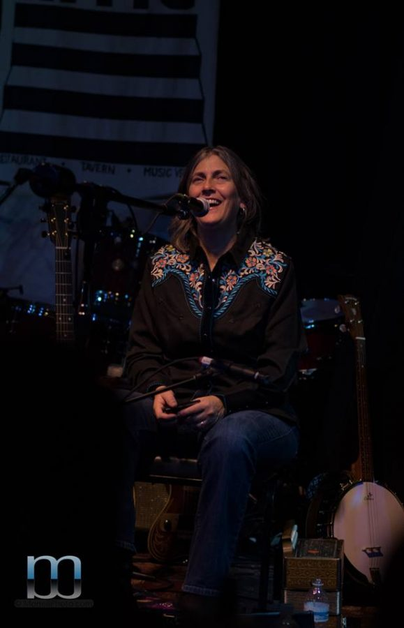 Becky Shaw is all smiles as she sings with Roxie Watson