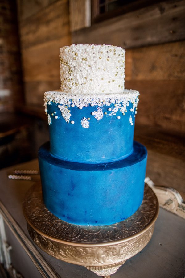 The wedding cake by Pastry Shells feautured a white cream frosting and vanilla cake.