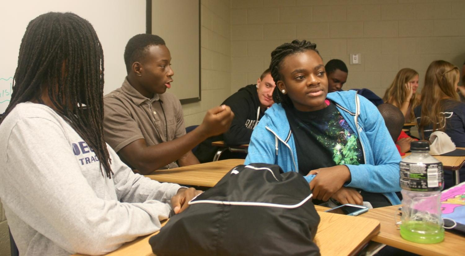 Juniors Martize Smith (center), Alia Bolden (right) and Eli Prejean (left) attend FCA's third meeting on Aug. 24.