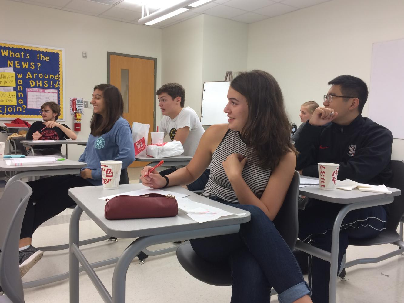 Junior Max Schneider, seniors Maya Karkare, Nate Rogers, Chiara Darnton and junior Ruiqi Zhang (left to right) follow along as Robert Schneider leads them through a complex number problem early in the morning on Sept. 7, 2017.