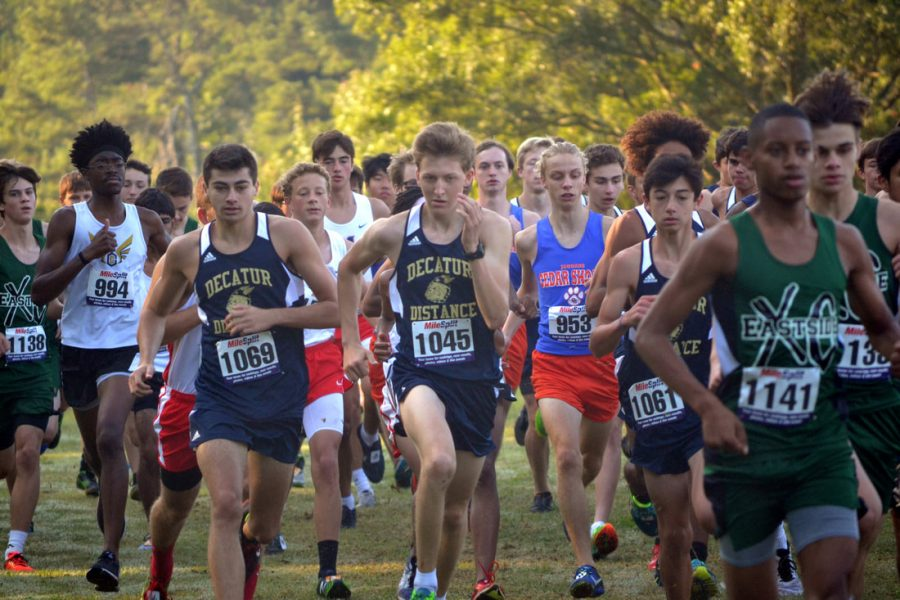 Senior Talmadge Studstill, Junior Sam Amick and Freshman Eoin McNally charge to the front of the pack. Amick, McNally and Studstill are attempting to lead the team to a second straight region championship.