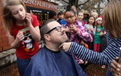 Teacher raffles off beard for student with cancer