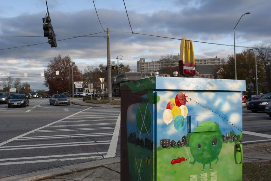 A painted traffic box houses the new traffic technologies implemented along Commerce and at the intersection of College Avenue and North McDonough.