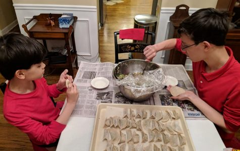Daniel and his younger brother preparing dumplings.