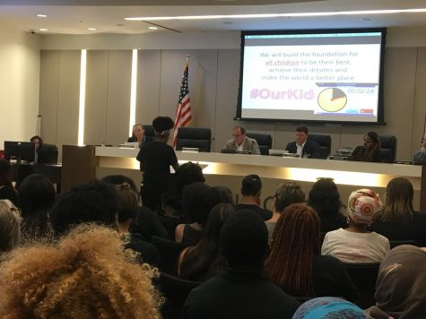 A student presents to the CSD Board of Education on behalf of the Beacon Hill Black Alliance for Human Rights, 2018.