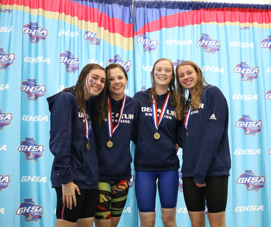 (from left) Jane Pfeufer, Hally Laney, Nadine Abrahamse and Annie Pfeufer took the top spot on the podium in the girls 400 freestyle relay.