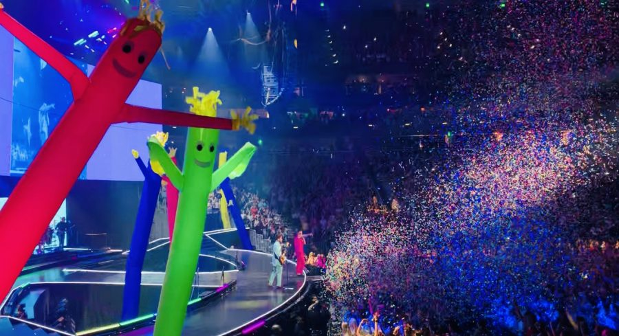 "During the chorus of ""Cake by the Ocean"", the crowd was showered with confetti and inflatable dancers shot up from the stage. Photo by Max Tyler."