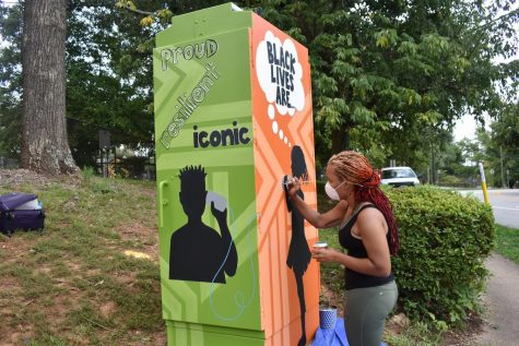 Artists paint uplifting message to the Black community on electrical box